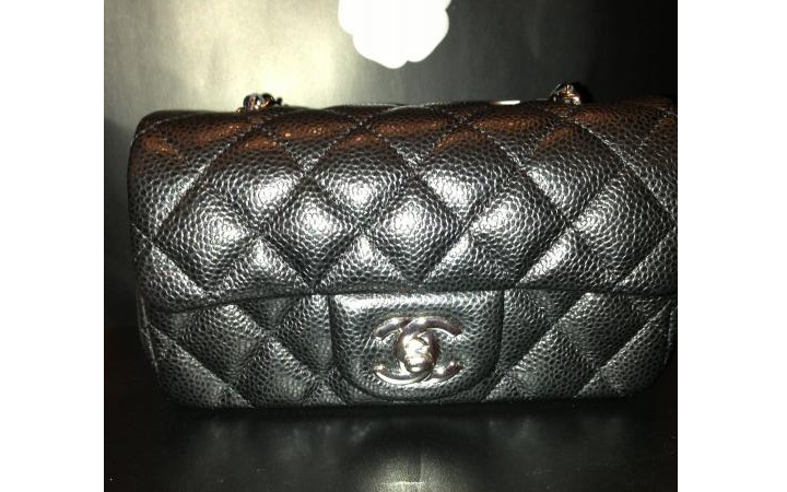 8edc3a8851b3 In Dadel's Collection We Found The Chanel Extra Mini Classic Flap Bag In  Black And Caviar