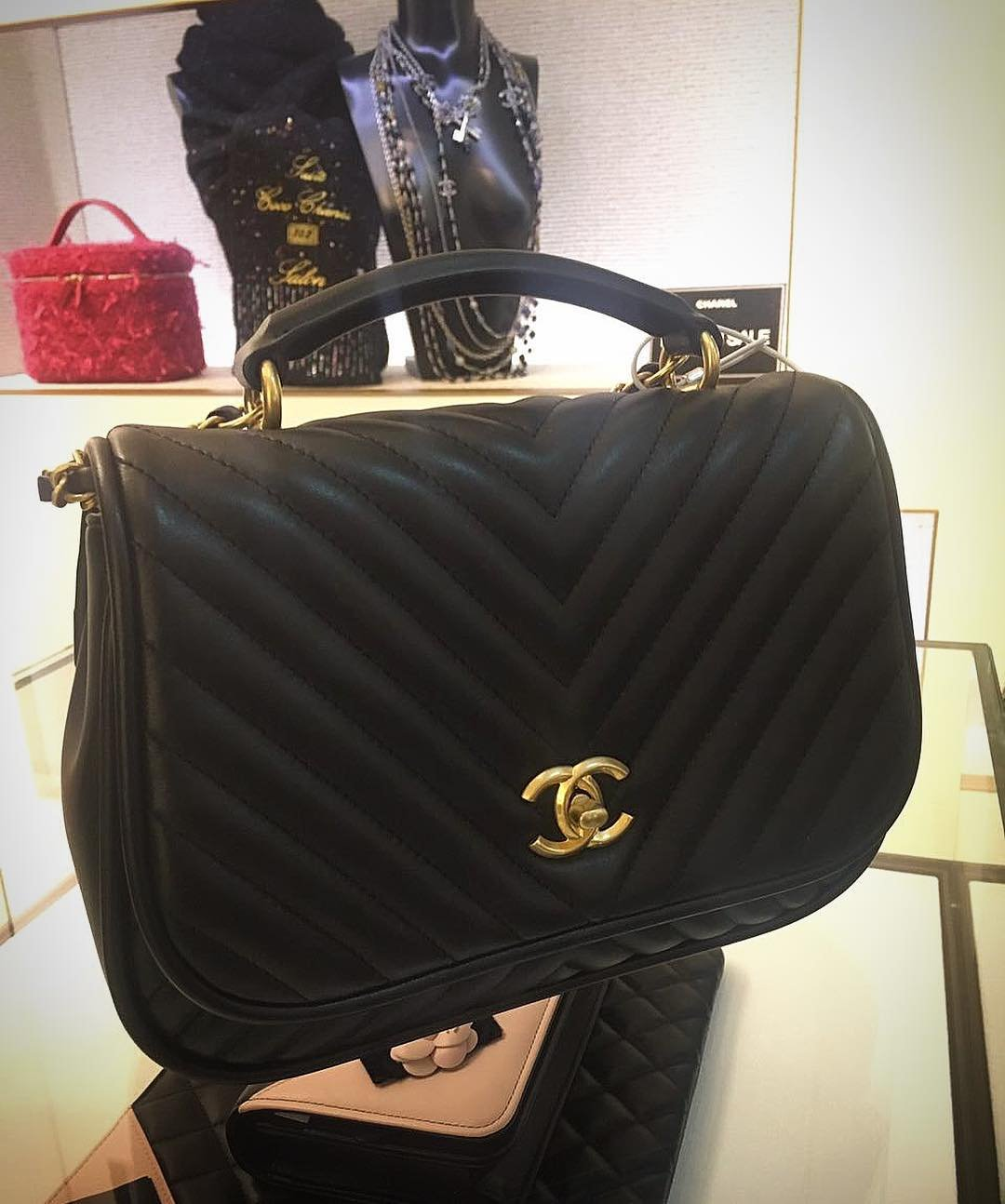 Chanel-Reversed-Chevron-Round-Flap-Bag-2