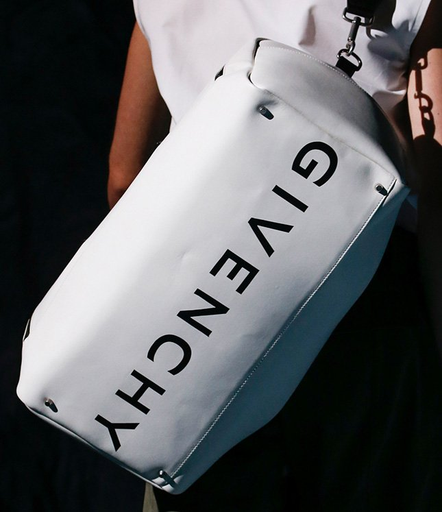 Meet the Givenchy Spring Summer 2019 Runway featuring new handbags like the  logo Duffle Bag and the feminine trapezoid shoulder bag that can be carried  as a ... 7f8ca5fc09ba9