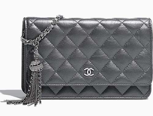 55b4352127fb Chanel Classic Quilted WOC With Signature Charm
