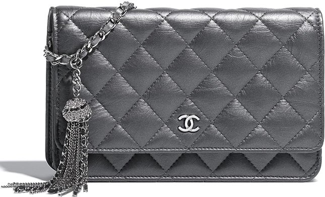 fa6fe579f3e7 Chanel Classic Quilted WOC With Signature Charm   Bragmybag