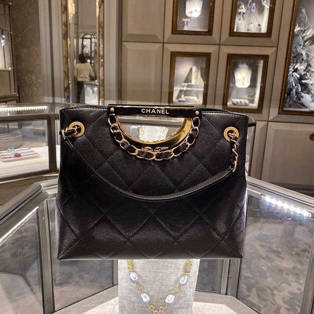 Louis Vuitton Woven Leather Handle Bag Collection